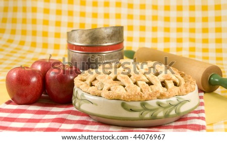 Home made Apple Pie with Red Apples and Rolling Pin - stock photo