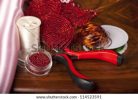 home made bead jewelry making as a hobby - stock photo