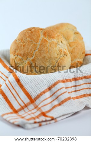 home made bread in a light background on a basket with orange square texture