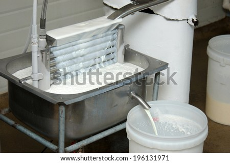 home-made brine cooling system cools milk drawn off from separator - stock photo