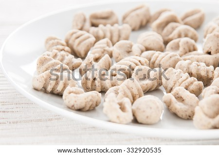 Home made buckwheat gnocchi (front view)  - stock photo