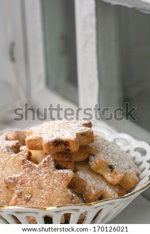 Home made butter cookies star shaped with dried cranberries and cranberry jam on an old window sill - stock photo