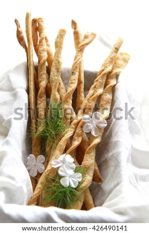 Home made cheese straws in a basket