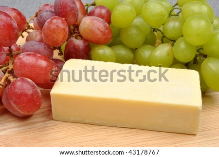 home made cheese with grapes in the background