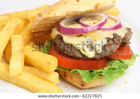 Home-made cheeseburger with fries. - stock photo