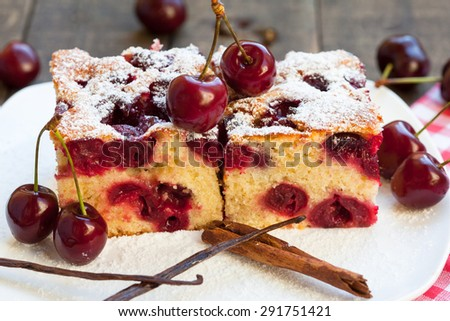 Home made cherry cake with vanilla and icing sugar - stock photo
