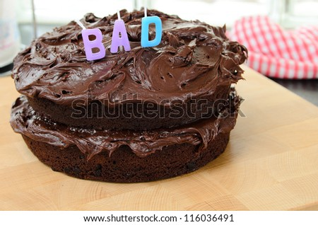 Home made chocolate cake with the word bad. - stock photo