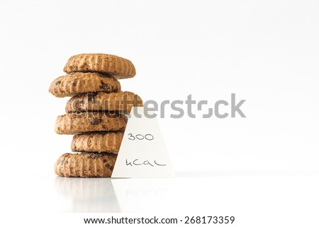 Home made chocolate chip cookies, calorie counting, diet concept - stock photo