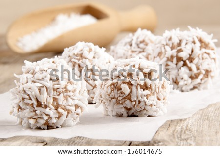 home made chocolate coconut truffle on baking paper - stock photo