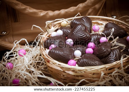 home made chocolates in metal basket with lady brown purse - stock photo