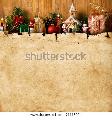 home made Christmas decoration and vintage paper on the wood background - stock photo