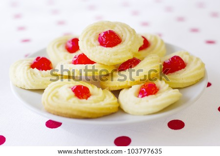 Home made cookies on red polka pot background - stock photo