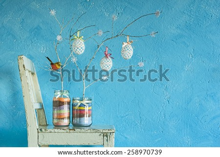 Home made Easter decoration on the background of a blue wall - stock photo