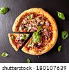 Home made fresh italian pizza with vegetable. Served on black stone surface. Shot from upper view - stock photo