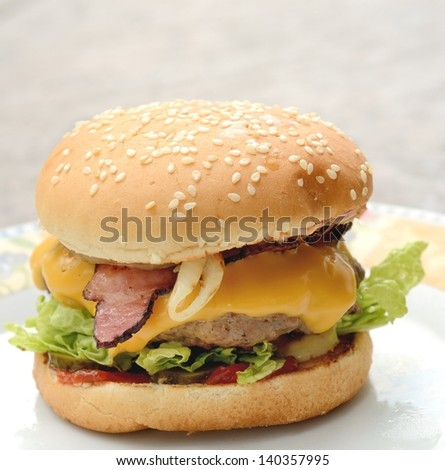 Home made hamburger with beef meat on the plate. - stock photo