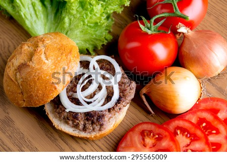 home made hamburger with meat,salad, onion, tomato and ketchup - stock photo
