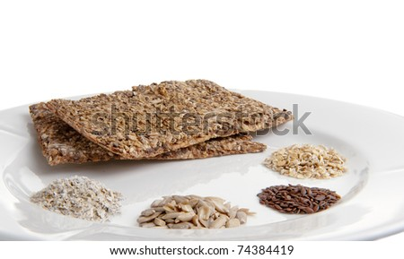 Home made healthy crackers and the ingredients for it. - stock photo
