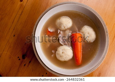 home made matzoh ball soup with carrots and chicken - stock photo