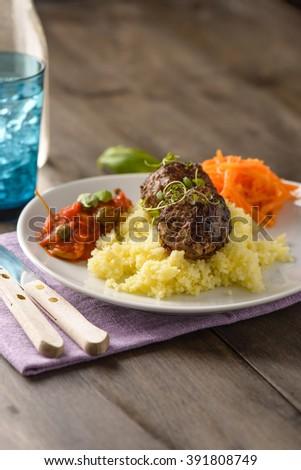 Home made meatballs on mash of potatoes and tomatoe sauce - stock photo