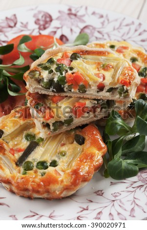 Home made mini quiche lorraine filled with vegetables - stock photo