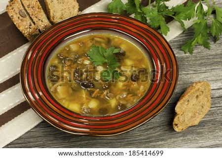 Home made mushroom soup with potato and carrot  - stock photo