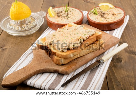 home made pate from scottish smoked mackerel with crushed peppercorn, rosemary and slice lemon on toasted bread