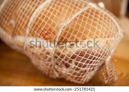 Home-made pickled ham prepared  by polish butcher. - stock photo