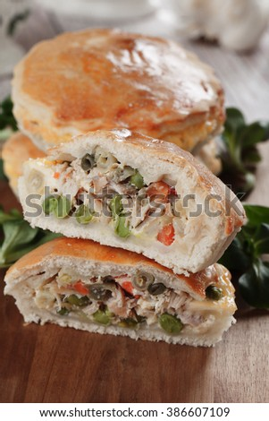 Home made pie filled with chicken meat and vegetables