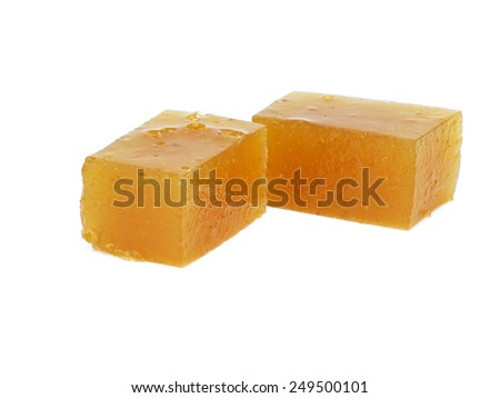 Home made quince jelly on a white background - stock photo