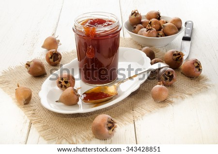 home made rose hip jelly in a glass - stock photo