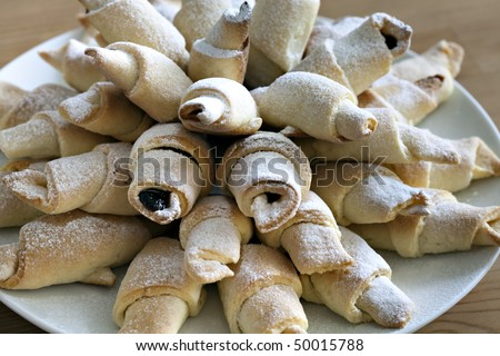 Home made sweet bakery. Crescent rolls stuffed with plum jam - stock photo