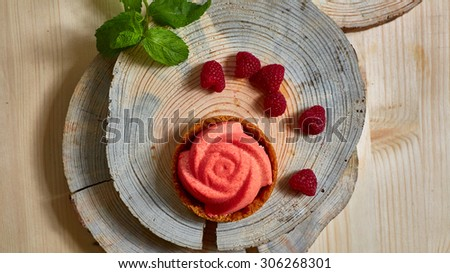 Home made tartlet rose on wooden background. Shallow dof - stock photo