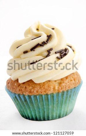 home made vanilla cupcake with chocolate sprinkles - stock photo
