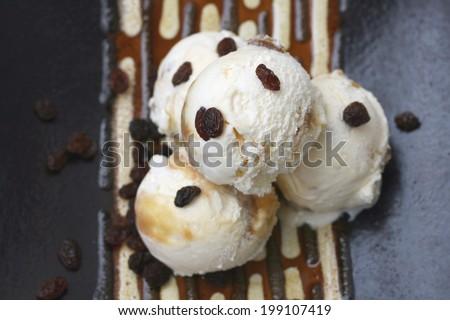 Home made vanilla ice cream with egg yolks, caster sugar, vanilla pods, double cream and malaga raisins - stock photo