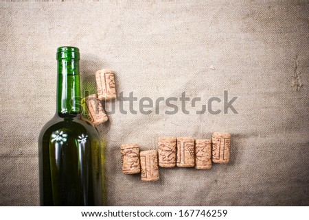Home made wine on vintage pattern fabric texture - stock photo
