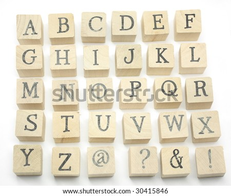 Home made wooden blocks spell out the alphabet - stock photo