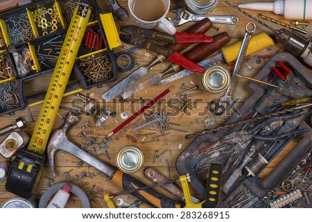 Home maintenance - An untidy workbench full of dusty old tools and screws. - stock photo