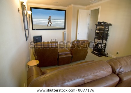 Home media room with big screen - stock photo