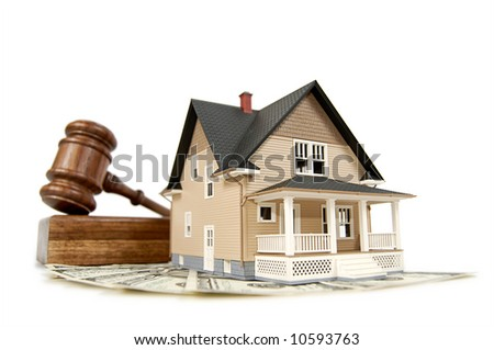 Home, money and gavel real estate concept; isolated on white with shallow depth of field - stock photo