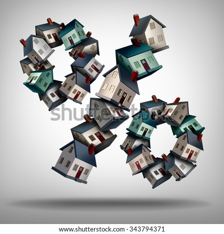 Home mortgage rates concept and interest rate symbol as a group of homes or houses shaped as a percentage sign for a house loan or real estate industry percent symbol. - stock photo