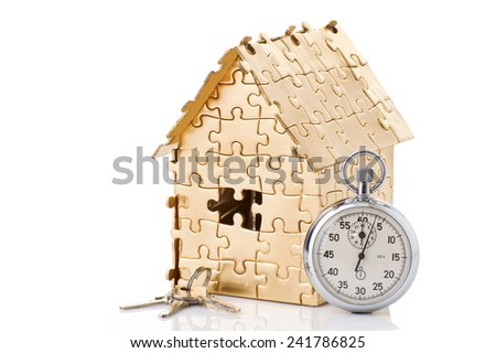 home of gold color with a stopwatch and a keys isolated on white background. Concept: time to buy a house - stock photo