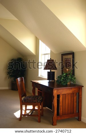 home office area with wood desk in an upscale new home - stock photo