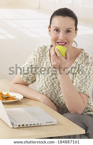 home office business woman having a quick lunch - stock photo