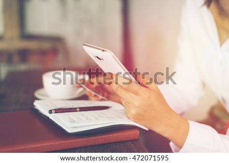 home office desk background,hand holding pencil and writing note on wood table,Checklist Notice Remember Planning Concept