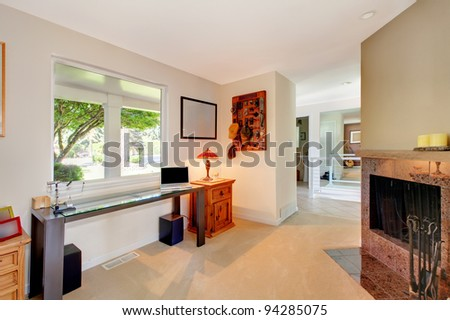 Home office small open room with fireplace - stock photo