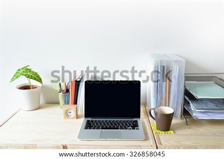 Home office table with computer, stationary and coffee - stock photo