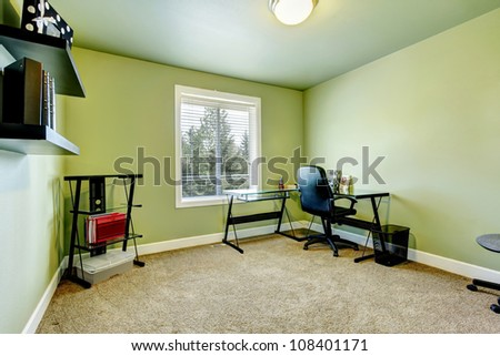 Home office with beige carpet and simple furniture. - stock photo