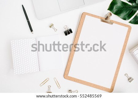 flat workspace home office. home office workspace mockup with laptop clipboard palm leaf notebook and accessories flat