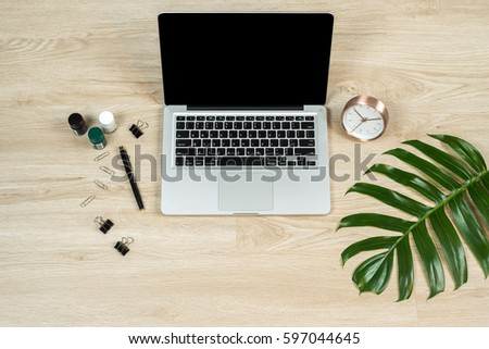 flat workspace home office. home office workspace with laptop palm leaf notebook and accessories flat lay k