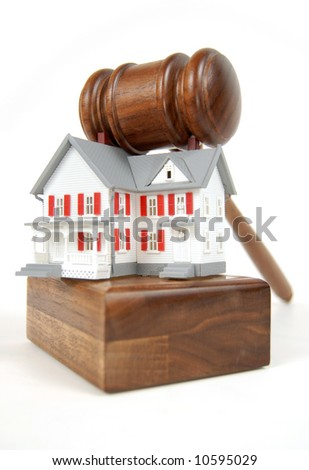 Home on an auction block; foreclosure, bankruptcy, etc. - stock photo